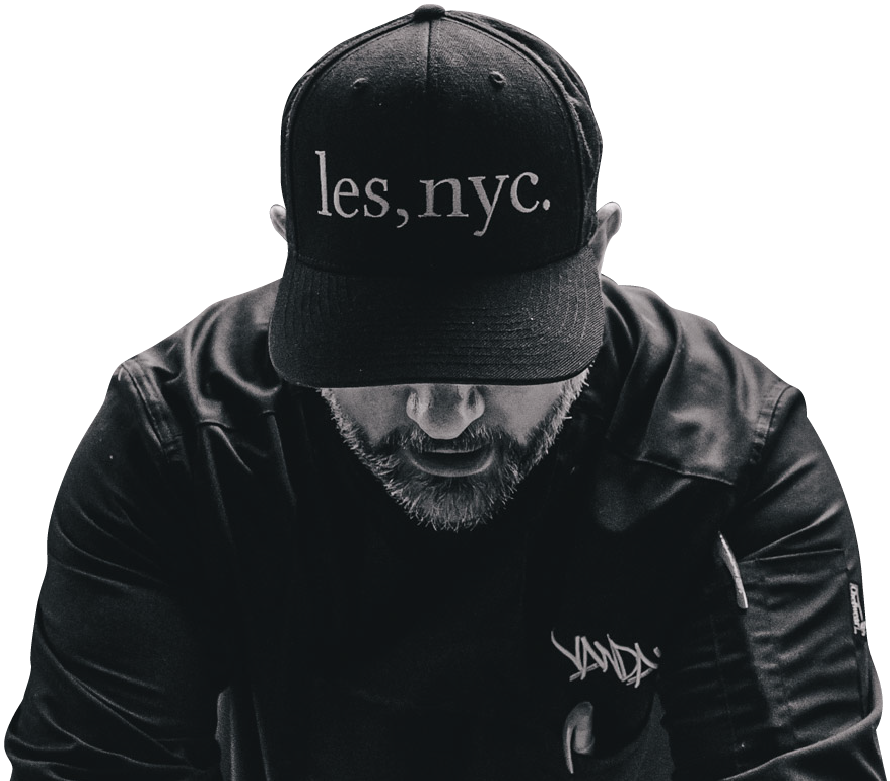 Chris Santos with hat that says Les, NYC